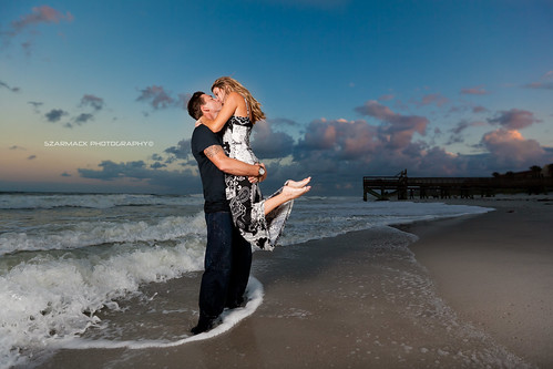 sunset sky beach girl up pier engagement kiss couple waves atlantic fl pick strobist