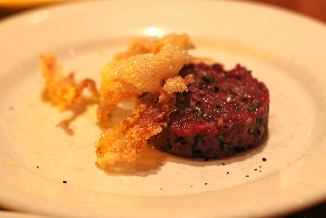 Beef heart tartare with puffed beef tendons