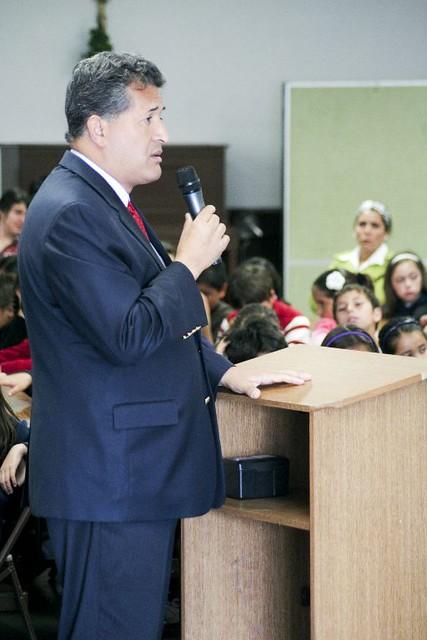 Juan speaking to school children