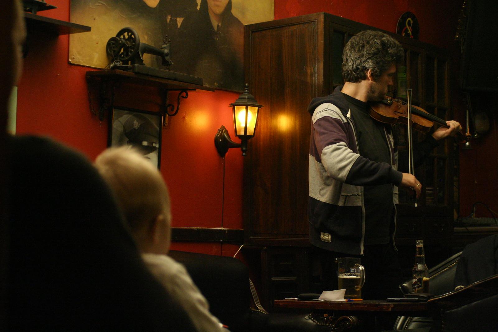 Neve watching Bojan play the violin.