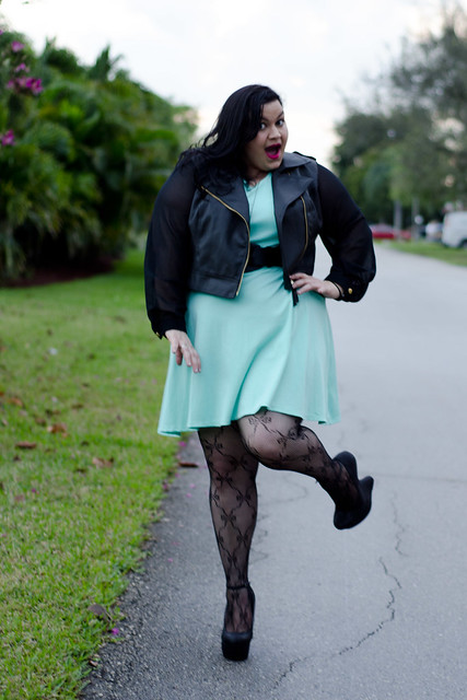 Kirstin Marie in mint green dress ,faux leather moto jacket, bow tights, & heel less heels all from Deb Shops