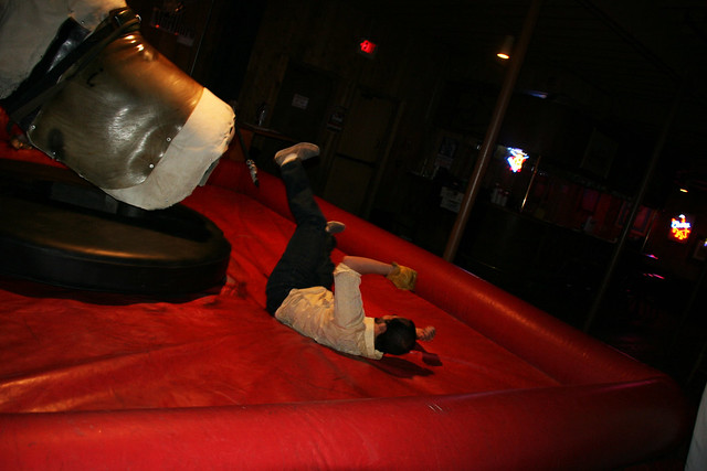 Dom falls off the mechanical bull