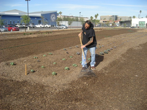 Ruben Herrera working in the garden.