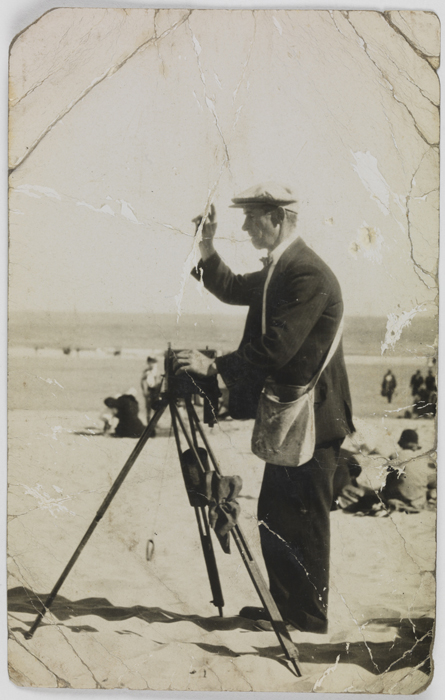 Postcard of an itinerant photographer working on a beach