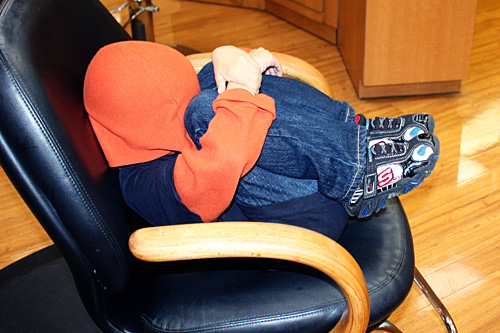 Nathan-covering-head-in-chair