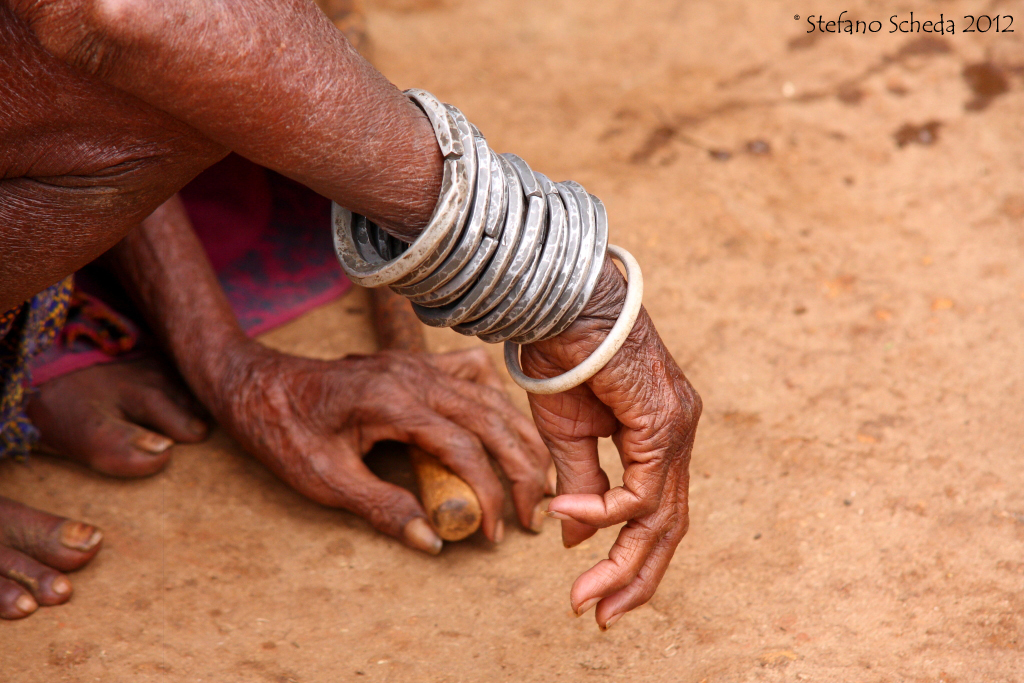 Elderly woman's silver bracelets - Orissa, India