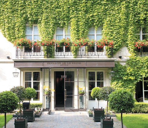 Hotel Pavillon de la Reine is tucked away in a flowering courtyard.