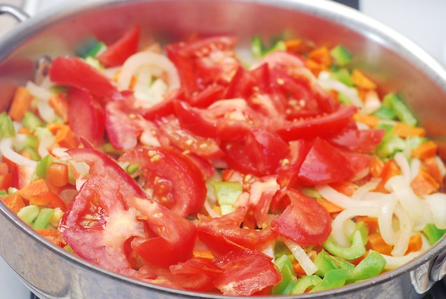 add tomatoes to the stew
