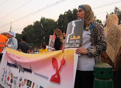 """Women demonstrating to demand equality with men. The big banner says """"No to child marriage"""". Credit: Cam McGrath/IPS."""