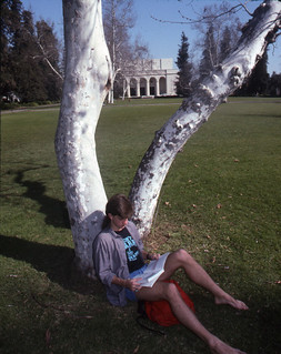 Student studying on the Quad in 1990