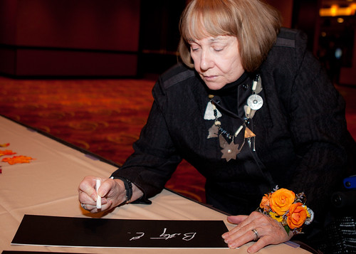 Betty Quadracci, one of our Hall of Fame honorees, signing a signature plaque at the Hall of Fame dinner.