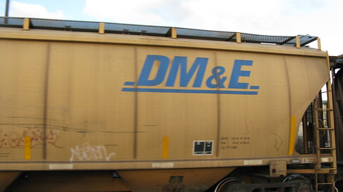 A former Dakota, Minnesota & Eastern Railroad covered hopper car up close.  Elmwood Park Illinois.  Late October 2012. by Eddie from Chicago