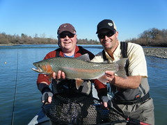 Lower Sacramento River fly fishing guide Jeremy Baker poses a trophy Lower Sacramento River Rainbow