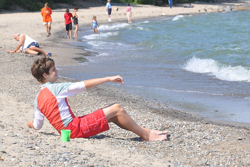 Benton tosses rocks into Lake Erie
