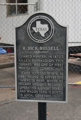 Photo of R. Dick Bussell black plaque