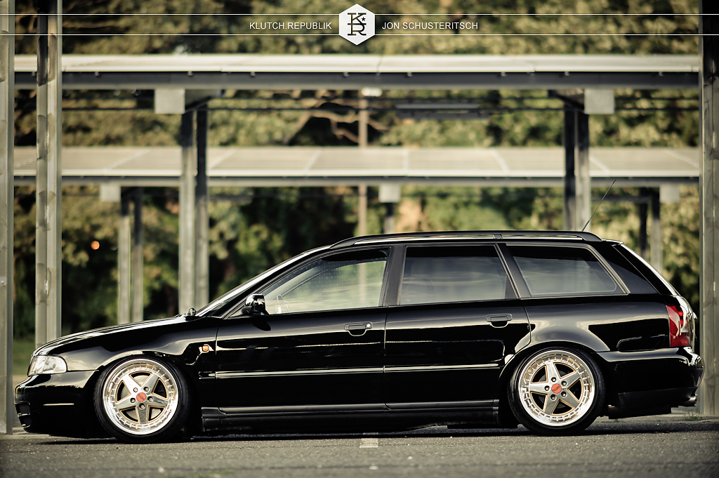 Dan Reinhart owner of Euro Kreations black audi b5 a4 avant wagon static low slammed fitted fitment hellaflush stance stanced 3pc gotti's polished and gold seen on klutch republik