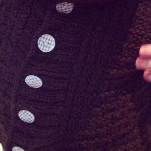 LB has some very cute buttons on his new hand knit hoodie. From the Cork Button Company. Cute as a button!