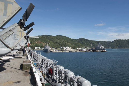USS Denver, center, USS Tortuga, right, sit along the pier as USS Bonhomme Richard arrives in Kota Kinabalu.