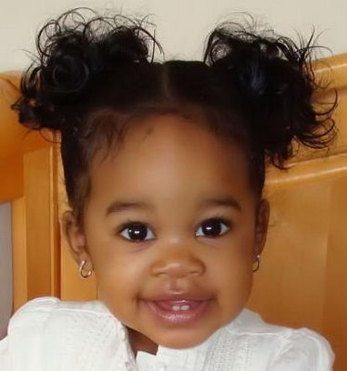 beautiful black baby girl with her pretty hairstyle with a sweet smile ...