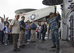 Ensign Derrick Ingle gives visitors a tour of the flight deck of USS George Washngton (CVN 73) Oct. 27 during the ship's port visit. (U.S. Navy photo by Mass Communication Specialist 3rd Class William Pittman)