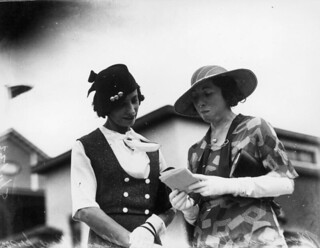 Two women picking a winner at the races, Brisbane, 1933