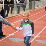 12-062 -- Beth Beaty '99 gives her son, 5-year-old Kyle, a high five at the finish of the Kids Fun Run.