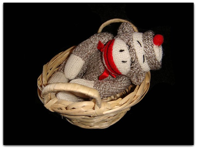 """A Sock Monkey looks so peaceful while sleeping."""