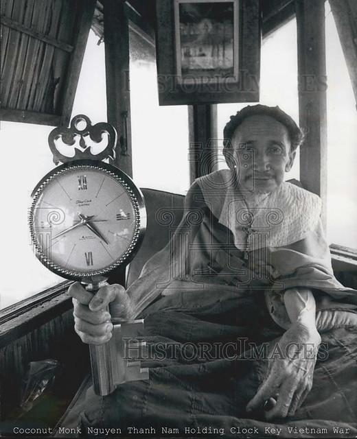 Coconut Monk Nguyen Thanh Nam Holding Clock Key