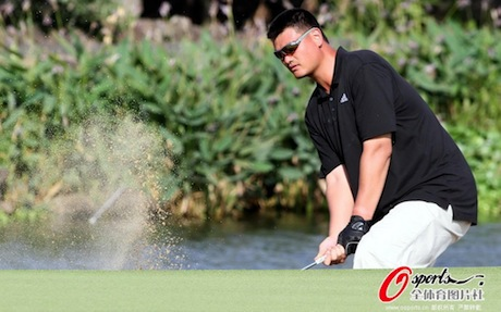 October 21st, 2012 - Yao Ming hits a shot out of the bunker at the Mission Hills World Celebrity Pro-Am Golf Tournament held October 19 to 21 in Haikou, Hainan Island