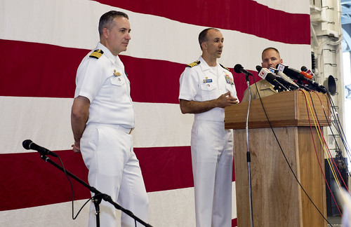 Capt. Cathal S. O'Connor (center), along with Capt. Daniel Dusek (left), , and Col. John Merna,  address local media