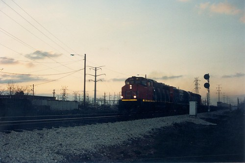Southbound Grand Trunk Western freight train passing through Hayford Junction at twilight.  Chicago Illinois.  May 1989. by Eddie from Chicago