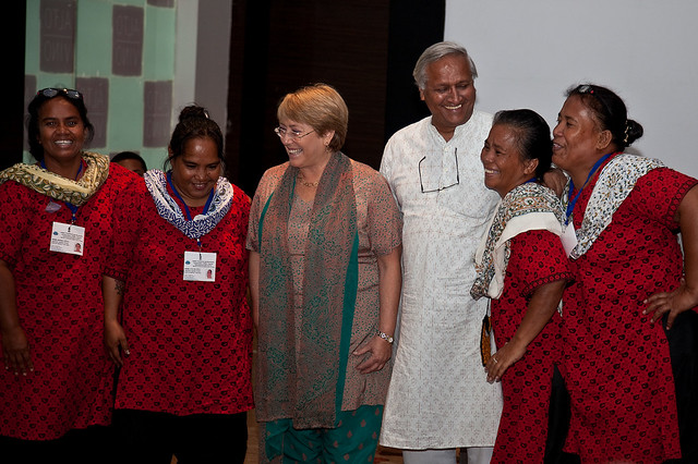 UN Women Executive Director Michelle Bachelet meets with women from Nauru who are attending a six-month training course in solar engineering at Barefoot College in Jaipur, India. Ms. Bachelet was hosted by Bunker Roy (third from right), the founder of Barefoot College.  Photo credit: UN Women/Gaganjit Singh Chandok