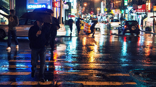 And I'm alone, out in the New York rain.