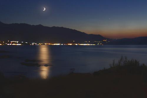 new city sunset sea moon reflection lights mediterranean over hillside