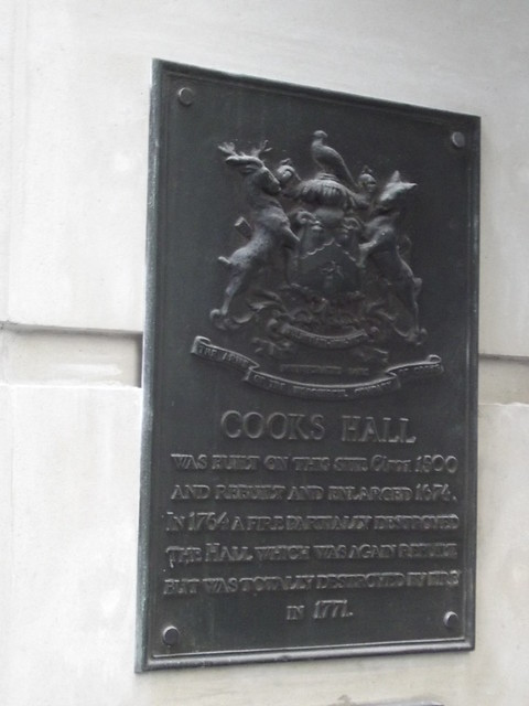Cooks Hall bronze plaque - Cooks Hall    Was built on this site circa 1500  and rebuilt and enlarged 1674.  In 1764 a fire partially destroyed   the Hall which was again rebuilt   but was totally destroyed by fire in 1771.