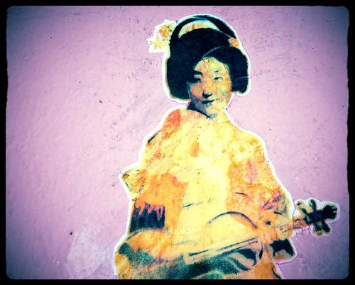 Violin gesha, sticker, wall near MOMA, San Francisco, California, USA by Wonderlane