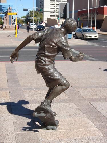 statue skateboarder