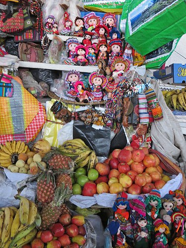 Inside San Pedro city market - fruits, dolls - Cusco, Peru