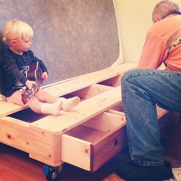 The scene right now as grandpa puts the finishing touches in Trues new big boy bed. #exciting #growingup