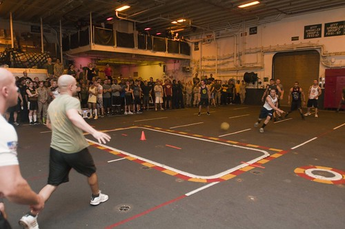 Sailors and Marines participate in a dodgeball tournament in the hangar bay