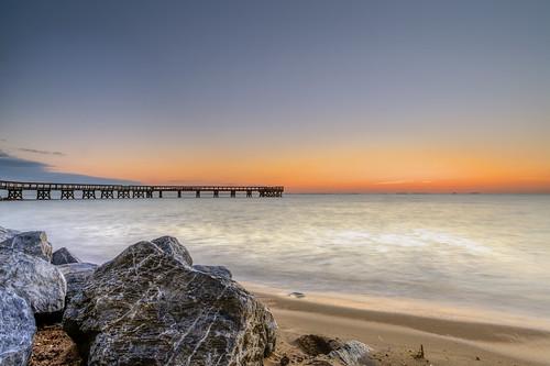 beach water night sunrise dawn pier sand maryland wave clear boulders pastels pasadena chesapeakebay orangeglow downspark dawnpatrol fallpatrol canon5dmkii ef1740f40lusm singhraydarylbensonrgnd