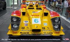 open-wheel car(0.0), porsche 962(0.0), formula one car(0.0), race track(0.0), supercar(0.0), race car(1.0), automobile(1.0), racing(1.0), vehicle(1.0), auto show(1.0), sports prototype(1.0), land vehicle(1.0), sports car(1.0),