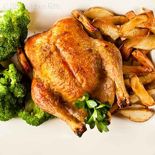 Roast Chicken on Platter with Broccoli and Roast Potatoes, Overhead View
