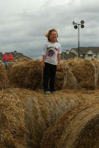 Catie on the hay bales at the farm