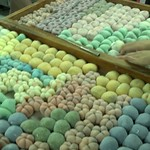 Neil-Lancaster-Food -- Hawaiian Mochi, a sweet treat made with rice flour and various innards ranging from a traditional bean paste with a strawberry to Twix and other candy bars. At the Two Ladies Kitchen in Hilo, they made Mochi in the traditional way, but combine it with more contemporary ingredients like candy bars and brownies. This blending of old and new is characteristic of much of Hawaiian culture, especially their food. - Neil Lancaster