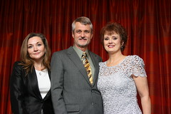 Shelly McKee, Robert S. Boyd and Karla Simmons pose in front of a red curtain.