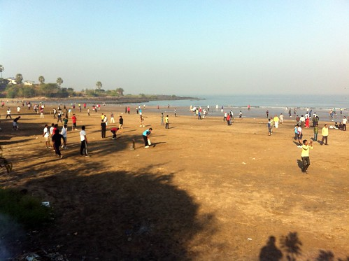 Community cricket playing at Madh