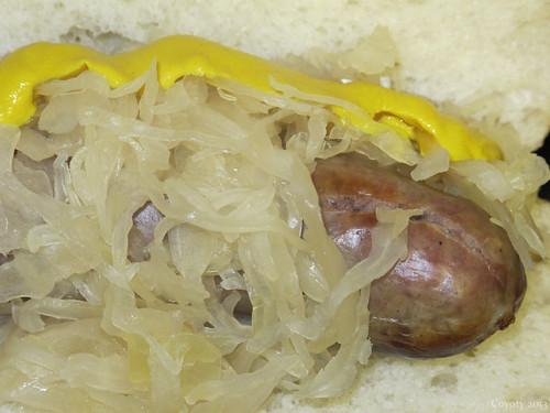 Bratwurst hoagie with sauerkraut and mustard by Coyoty