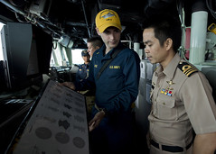 In this file photo, Ensign Codie Rose displays flight deck parking charts to a visiting Royal Thai Navy officer during Feb. 2, prior to exercise Cobra Gold. (U.S. Navy photo by Mass Communication Specialist 3rd Class Amanda S. Kitchner)