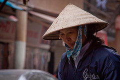 Woman with a Conical Hat in The Old Quarter - Hanoi, Vietnam